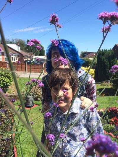 Me and my crazy haired cousin amongst the verbena at Grandmas