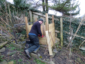 Dad, vermin-proofing the new compost bin